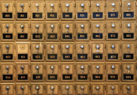 an array of old mail boxes in a post office Stock Photo
