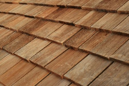 roof shingles: Diagonal detail of brown wood roof shingles Stock Photo