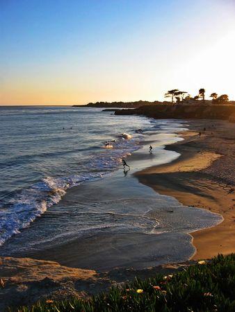 People playing on a beach in Santa Cruz, California near sunset Stock Photo - 3577873