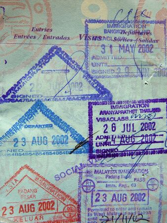 passport stamps from Thailand and Malaysia in a US passport                                photo