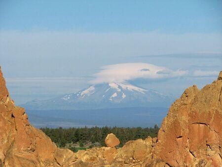 Mount Jefferson with a lenticular cloud seen through Asterisk pass, Smith Rock, Oregon Stock Photo - 3578045
