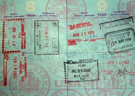 passport stamps from Europe and North America in a passport