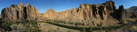 rock formation: panorama of the front side of Smith Rock state park, Oregon with the crooked river and cliffs Stock Photo
