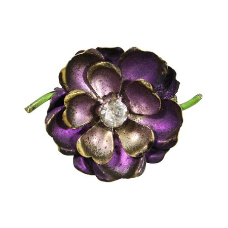 antique jewelry pin of a purple flower with gem in the center isolated on white Stock Photo