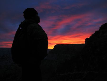 Woman hiker silhouette with an orange sunrise in the Grand Canyon, Arizona Stock Photo - 3584355