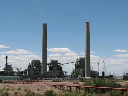 cholla: two smokestacks from the coal fired Cholla power plant in Arizona against a sky