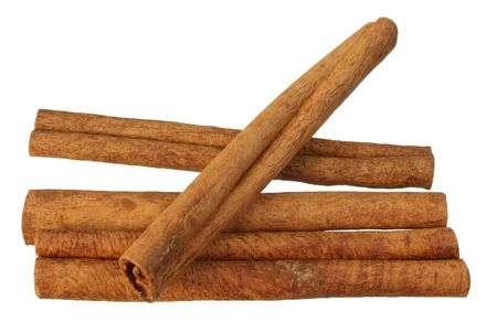 cinnimon: four cinnamon sticks isolated on white