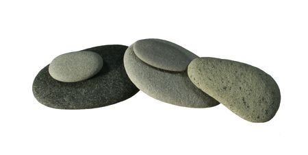smooth: piled smooth flat gray and light gray pebbles isolated on white background