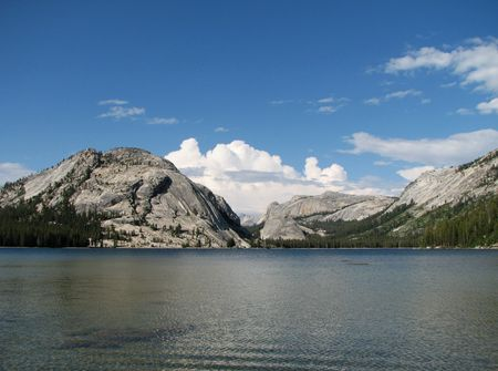 View from the west end of Tenaya lake showing Stately Pleasure dome, Medlicott dome, and a blue sky with clouds Stock Photo - 3596612