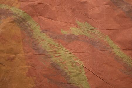 painted brown and green crumpled background