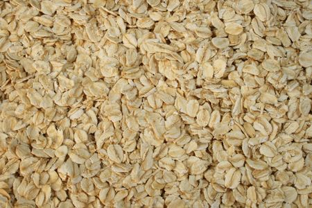 background of dry rolled oats or oatmeal Stock Photo - 3596536