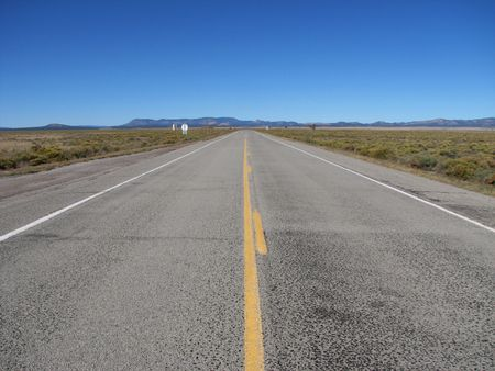 empty highway 60 cuts straight across the Plains of San Agustin, New Mexico to the horizon Stock Photo - 3596621