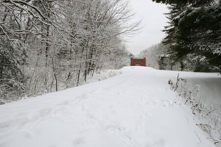 snowy path leading to a red brick building Stock Photo - 3596539