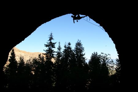rockclimber: silhouette of rock climber climbing the roof of the pipedream cave, Maple Canyon, Utah