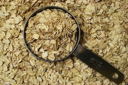 avena en hojuelas: antecedentes de las tierras secas laminadas avena o harina de avena con media taza de medir