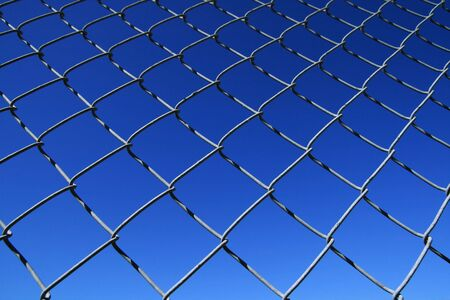 chain link fence mesh with blue sky background Stock Photo - 3608710