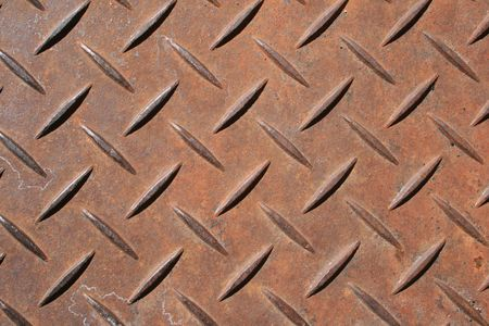 non skid:  raised diamond pattern rusted steel panel