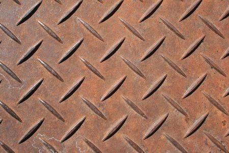 raised diamond pattern rusted steel panel Stock Photo - 3612574