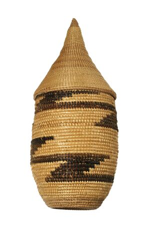a tall pointy lidded tan African basket with darker design Stock Photo - 3612558