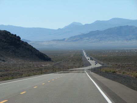 a mirage: I-95 in Nevada fades off into the distance with heat ripples and mirages