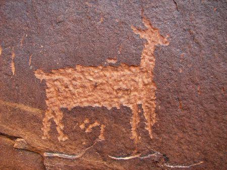 anasazi: Anasazi petroglyph of deer on sandstone cliff Stock Photo