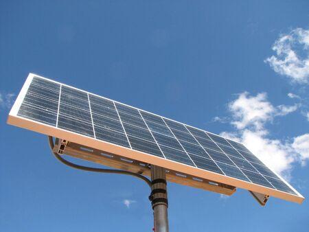 a photovoltaic solar panel against a blue sky with cloud Stock fotó