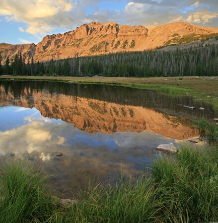 uinta mountains: square image of Mount Hayden and reflection in a small pond in the Uinta Mountains, Utah Stock Photo