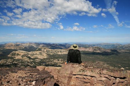a man enjoys the view of the Uinta Mountains from the summit of Mount Hayden, Utah Stock Photo - 3634177