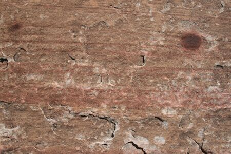 flaking: flaking sandstone background surface with red spots