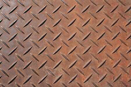 non skid: rusted textured steel panel with raised diamond pattern Stock Photo
