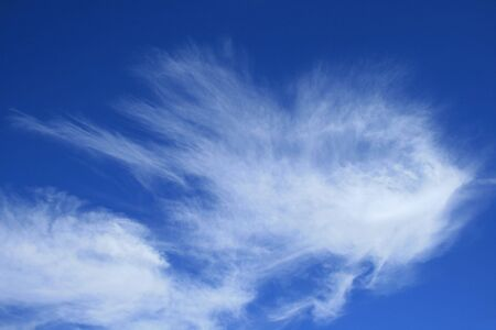 wispy: horizontal image of blue sky with wispy white  cirrus clouds Stock Photo