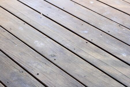 screwed: dark cracked wooden deck surface with screwed