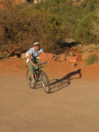 Asian woman on a mountain bike on a dirt road near Sedona, Arizona Stock Photo - 3655669