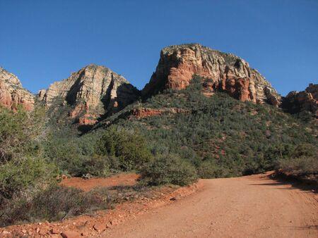 a dirt road runs towards red sandstone cliffs near Sedona, Arizona Stock Photo - 3659488