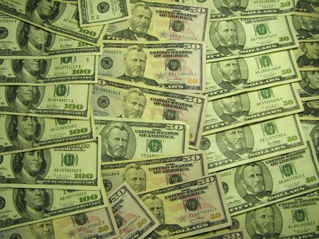 moola: A number of 50 and 100 dollar bills spread out as a background. Stock Photo