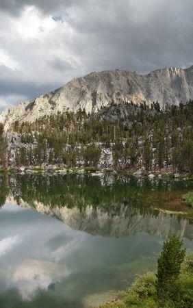 gilbert: reflection in Gilbert Lake, Sierra Nevada, California. Vertical image