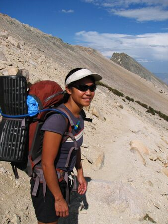 an Asian woman hiking over Kearsarge pass in the Sierra Nevada, California Stock Photo - 3655725