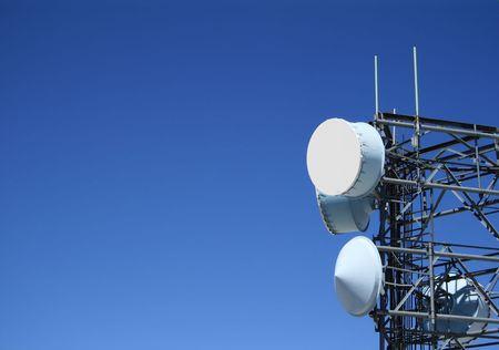 microwave antenna: microwave antenna tower with plenty of blue sky copy space to the side Stock Photo