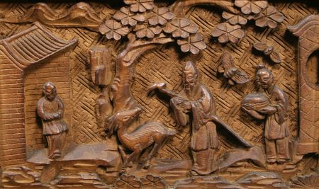 Asian carved wood panel with tree, buildings, deer, and three people Stock Photo - 3691491