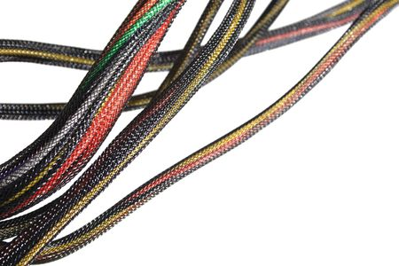 a number of bundled colored wires in black mesh isolated on white with shallow depth of field and copy space Stock Photo - 3691490