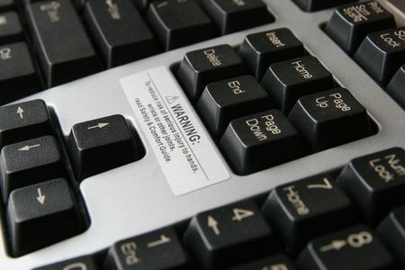 close up of carpal tunnel warning on gray and black computer keyboard Stock Photo - 3701326