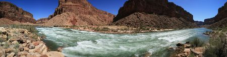 panoramic of the Colorado River flowing through Badger Creek rapid in Marble Canyon, Grand Canyon, Arizona Stock Photo