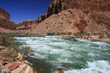 the Colorado River flows through Badger Creek rapid in Marble Canyon, Grand Canyon, Arizona Stock Photo - 3747868