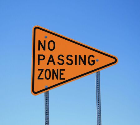 no passing zone road sign in yellow and black on blue sky background Stock Photo - 3747683