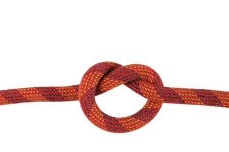 overhand or thumb knot in red climbing rope isolated on white