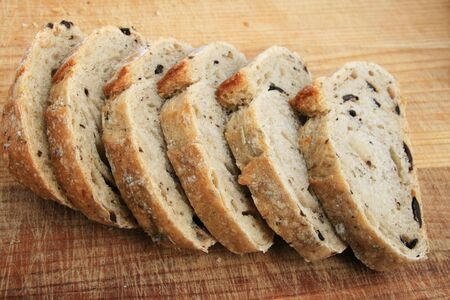 rosemary kalamata olive bread slices on wooden cutting board Stock Photo - 3762685
