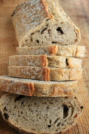 rosemary kalamata olive bread loaf and slices on wooden cutting board Stock Photo - 3762682