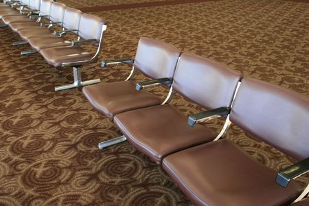 row of empty brown seats in an airport passenger waiting area Stock Photo - 3849060