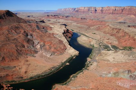 view down down to Lees Ferry from high on the Spencer trail with Colorado River, Marble Canyon, Vermilion Cliffs, and Kaibab Plateau visible