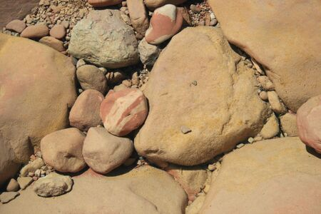 underwater colorful rounded pebbles and cobbles in a river bed photo